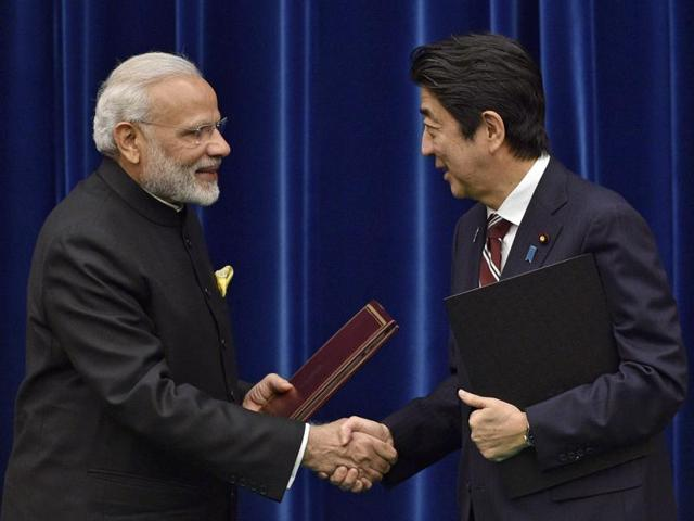 Prime Minister Narendra Modi, left, and Japanese Prime Minister Shinzo Abe shake hands joint press conference at Abe's official residence in Tokyo, Japan.