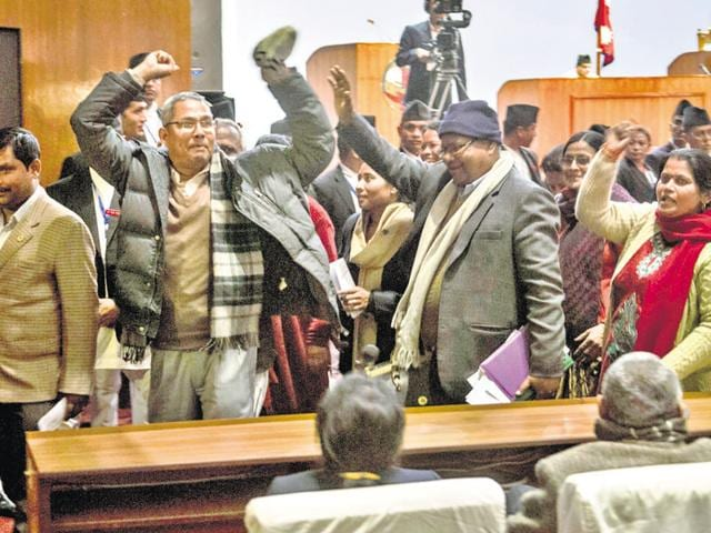 Nepalese lawmakers stage a protest as other lawmakers vote a constitution amendment bill in Kathmandu.