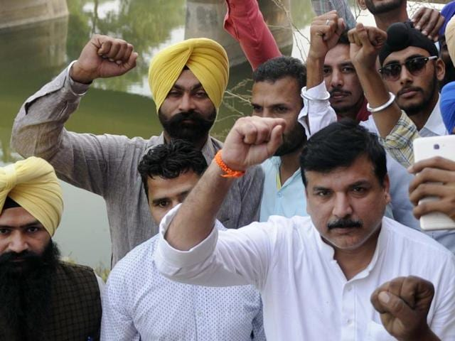 AAP leader Sanjay Singh with party workers near Kapuri village in Patiala on Friday.