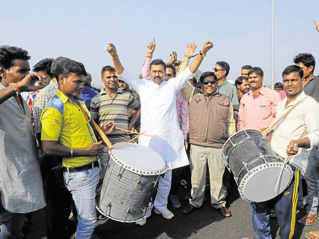 "BJP MLA Vishnu Khatri celebrates after the alleged encounter of SIMI men in Bhopal. BJP leaders have begun delivering speeches underlining the government's ""achievement"" in curbing terrorism."