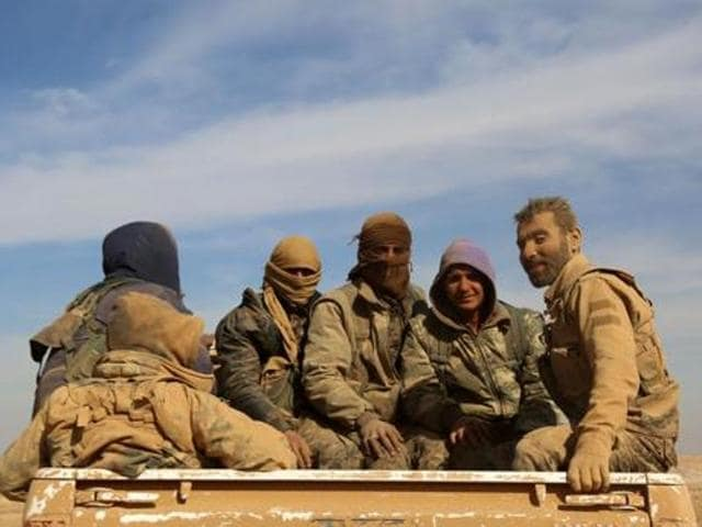 A Syrian Kurdish-led force fighting the Islamic State group north of the country is on the verge of surrounding a wide area north of the IS stronghold of Raqqa.