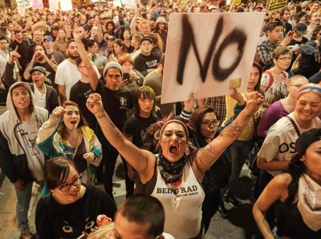 Demonstrators gather to protest a day after President-elect Donald Trump's victory, at a rally outside Los Angeles City Hall in Los Angeles, California.