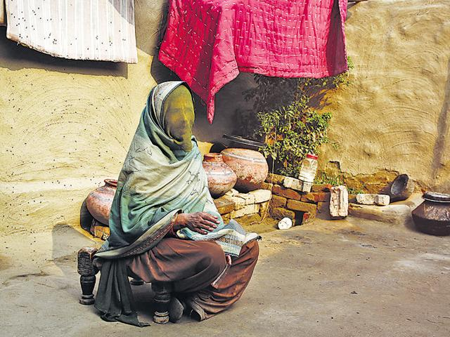 A woman who was trafficked to Haryana covers her face. In areas with poor sex ratio, trafficking of brides from other states is common.
