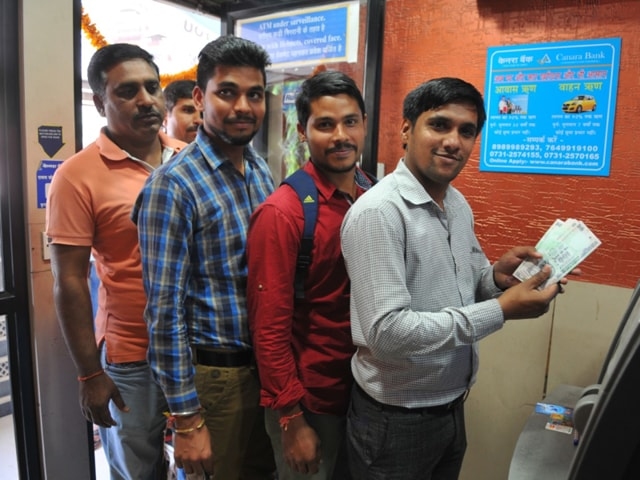 On Friday, ATMs opened to long queues, as people scrambled to withdraw money.