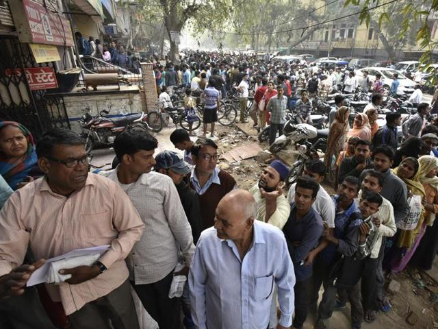 A line outside an ATM in Delhi. Millions of panicked consumers lined up outside banks and ATMs across India on Friday to exchange withdrawn banknotes but chaos ensued for the second straight day with poor cash flow and no signs of immediate relief.