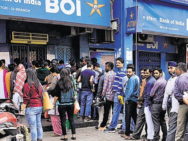 People standing in queues outside a Bank of India branch in Sector 32, Chandigarh, on Friday. .