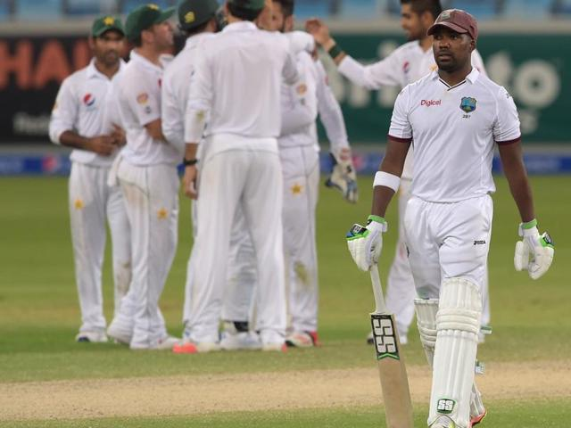 West Indies batsman Darren Bravo (right) celebrates his century with captain Jason Holder in the first day-night Test against Pakistan in Dubai in October. The senior batsman has been axed from the ODI squad for indiscipline.