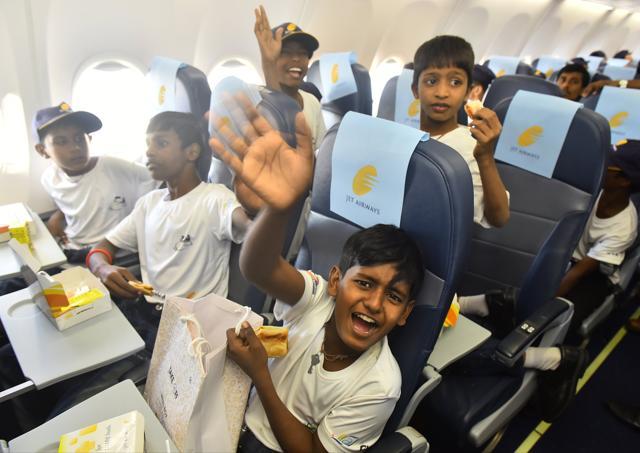 Children enjoy an in-flight meal.