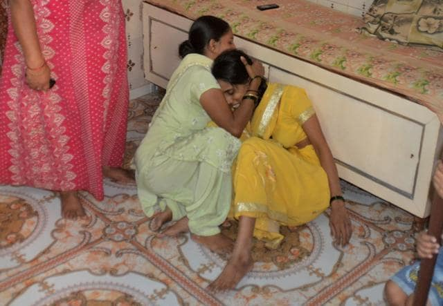 Anerao's wife (right) mourns the death of her husband and daughters at their residence in Sakinaka in Mumbai, on Saturday.