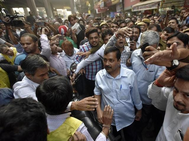 Delhi chief minister Arvind Kejriwal with shopkeepers in New Delhi on Saturday.