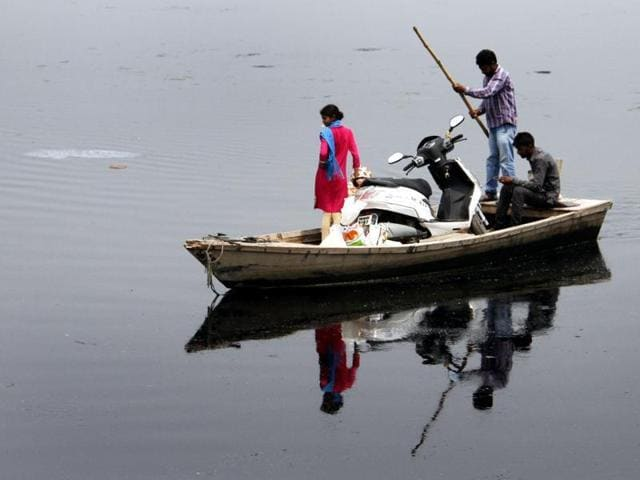 People crossing the Sutlej river in boat near a village. The water-sharing dispute is likely to become a major issue with the opposition Congress turning the heat on the Badal government ahead of next year's assembly polls.