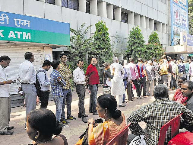People line up at Punjab National Bank branch for note exchange, in Bhopal on Friday.