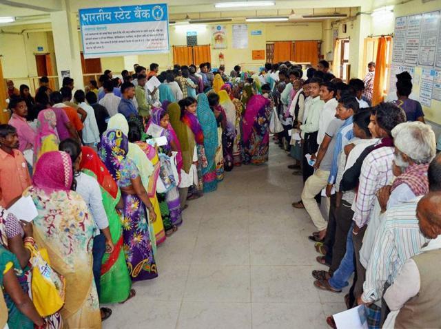 Queues outside banks,Bank ATMs,Chaos at banks