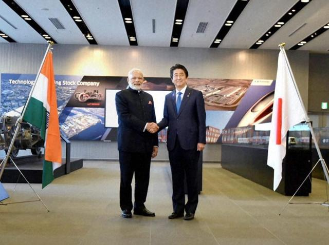 Prime Minister Narendra Modi shakes hands with his Japanese counterpart Shinzo Abe during his visit to Kawasaki Heavy Industries (KHI) Hyogo Plant, in Kobe on Saturday.