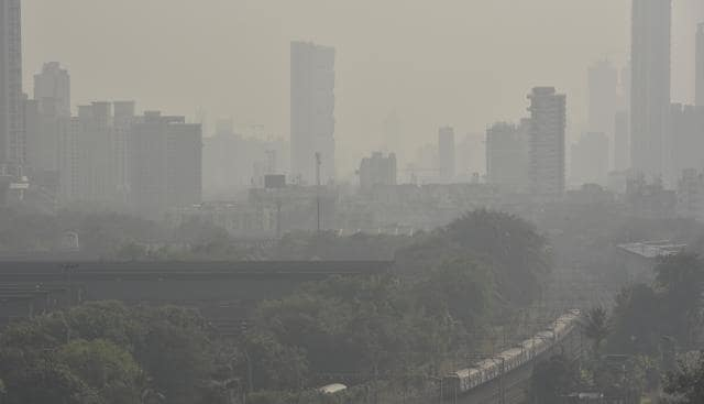A local train arrives at Parel station as Mumbai stays engulfed in smog, on Saturday.