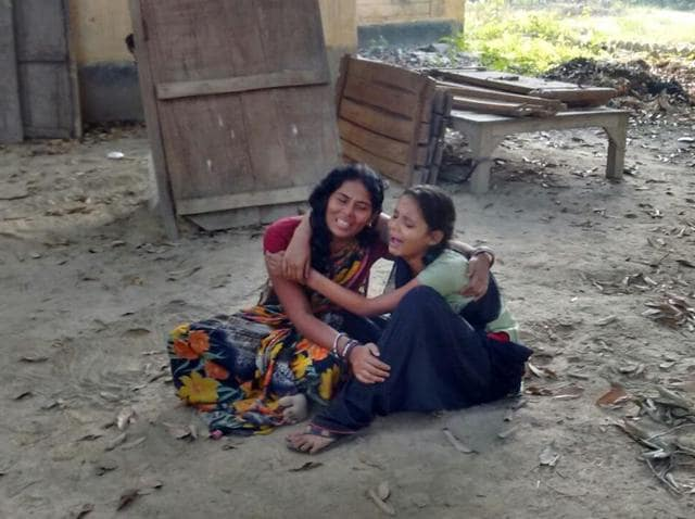 Mala Devi, left, the wife of deceased hawker Sikander Singh, in Begusarai, on Sunday.