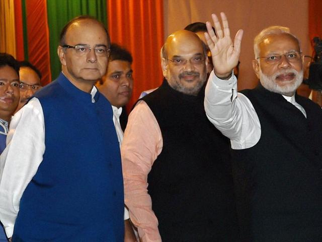 Prime Minister Narendra Modi with BJP president Amit Shah and finance minister Arun Jaitley during the Diwali Mangal Milan programme at BJP headquarters in New Delhi.