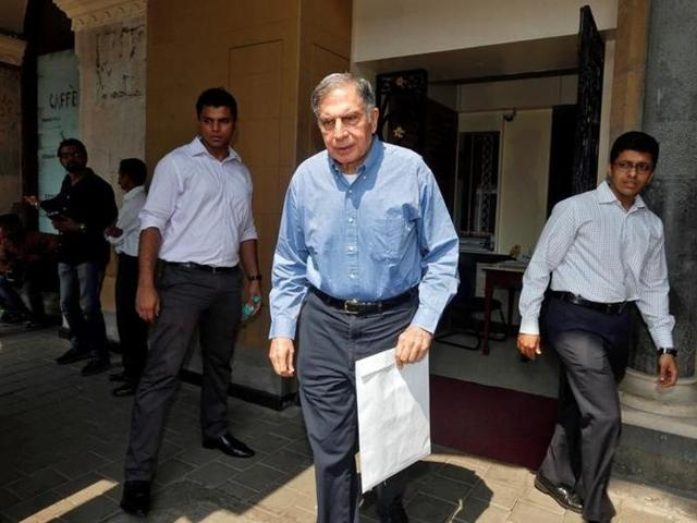 Ratan Tata, interim chairman of India's Tata group, leaves his office building in Mumbai.