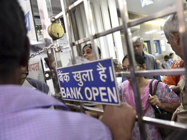 Bankers are working overtime even in the holidays to cater long queues of customers to exchange their old notes for the new ones.