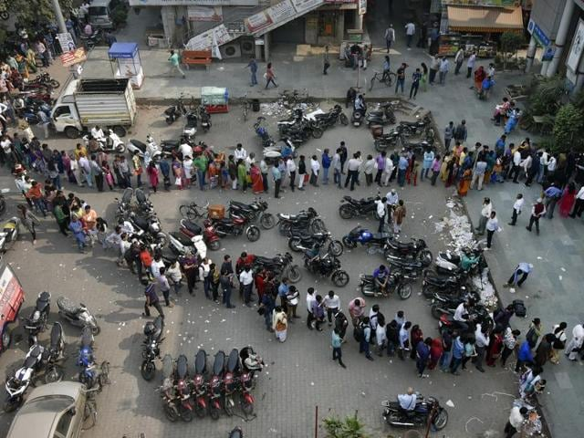 People stand in a long queue to exchange their old Rs 500 and 1000 notes outside the bank at Mayur Vihar in New Delhi.