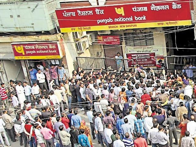 A huge rush of customers outside the Punjab National Bank branch at New Shivpuri area in Ludhiana on Saturday.