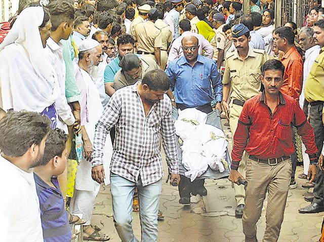 Police taking the dead bodies of the three sisters who were killed by their father Mangesh Anerao.
