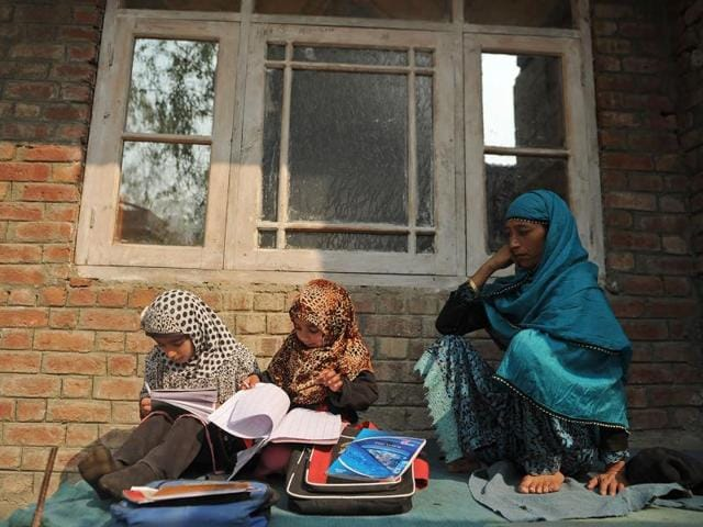 Kashmiri students study outside a house on the outskirts of Srinagar on November 2, 2016. A total of one lakh students from Classes 10 and 12 are expected to appear in the annual examinations that are taking place against the backdrop of heightened tension between locals and security forces.