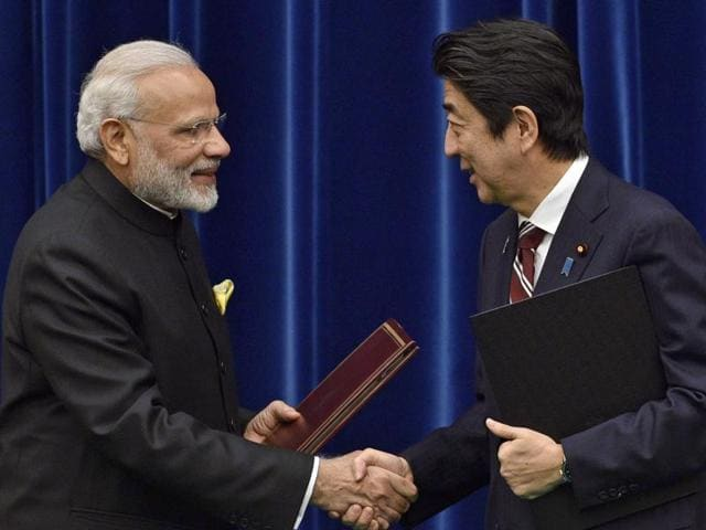 Prime Minister Narendra Modi and Japanese Prime Minister Shinzo Abe watch foreign secretary S Jaishankar and Japan's ambassador to India Kenji Hiramatsu exchange the Nuclear Agreement documents in Tokyo on November 11, 2016.