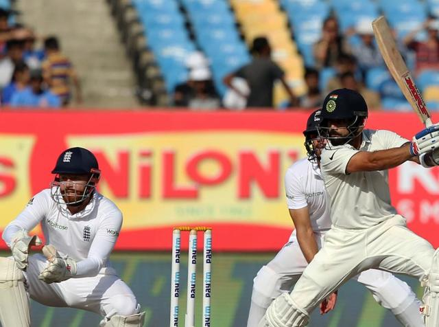 Virat Kohli's unbeaten 49 helped India hang in and draw the first Test against England in Rajkot.