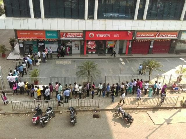 Long queues seen outside an ATM in Parel ,which had some cash left, while most ATMs in the city remained closed.