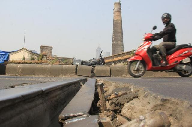 """When inquired about the new gap, civic officials said that they were aware of the loosened concrete near the ITC section of the flyover and would soon take up the repair work. """""""
