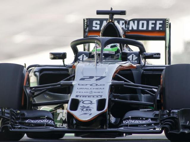 Force India F1 Team driver Nico Hulkenberg tests the so-called halo cockpit protection device during first practice session of the Formula One Brazilian Grand Prix , in Sao Paulo, Brazil on November 11, 2016. / AFP PHOTO / Miguel SCHINCARIOL