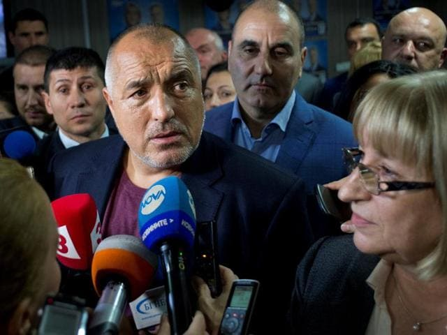 Bulgarian Prime Minister Boyko Borisov (L) speaks during a joint news conference with Tsetska Tsacheva (R), Presidential candidate of the Bulgarian Citizens for European Development of Bulgaria (GERB) in Sofia early on November 7, 2016.