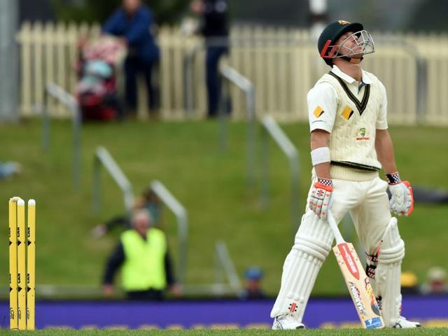 South Africa's Kyle Abbott reacts as he dismisses Australia's David Warner.