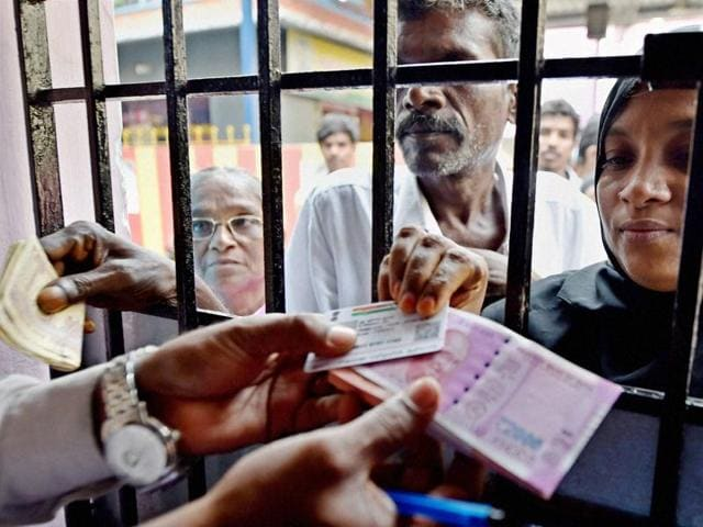 People exchange their old 500 and 1000 rupee notes at special camp organised by a public sector bank in Chennai on Saturday.