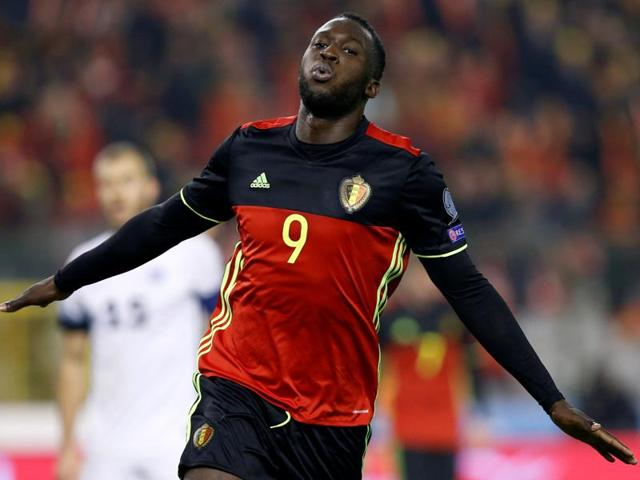Belgium's Romelu Lukaku celebrates with team mates after scoring against Estonia.
