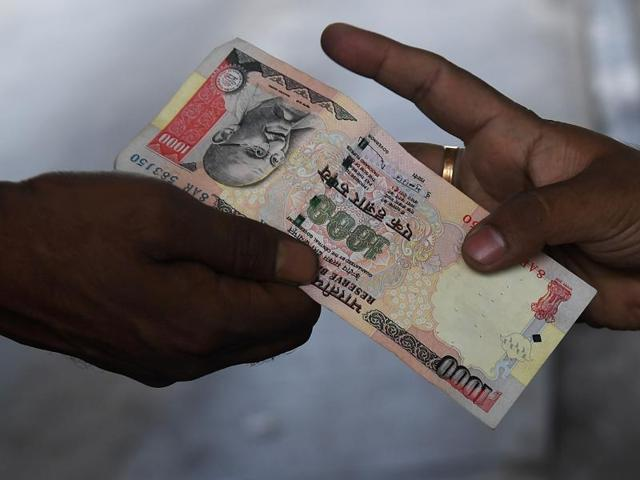 Police sources said  Satyapal, 37, who runs a food takeaway shop, was carrying old notes of Rs 500 and Rs1,000. He had planned to exchange the notes with shopkeepers so that he could use the money for a relative's marriage.