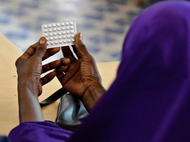 A female religious leader takes notes during a session at the local maternity facility on what Islam allows and does not allow in terms of family planning, and on the benefits of family planning in Wajir Town , Kenya.