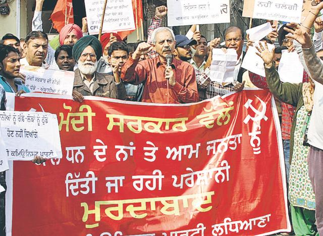 CPI workers protesting against the government at Kailash Chowk in Ludhiana on Sunday.