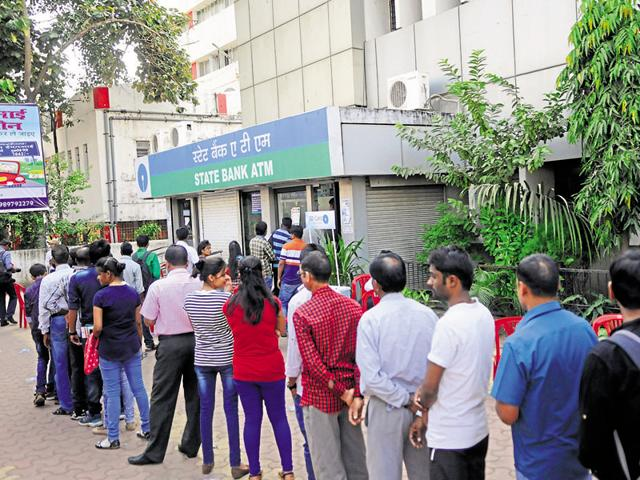 People queue outside a State Bank of India ATM in Bhopal on Sunday.