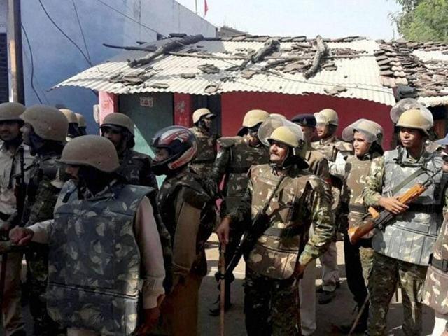 Cops patrol a curfew bound locality in Vidisha on Sunday following the murder of Bajrang Dal worker Deepak Kushwah.