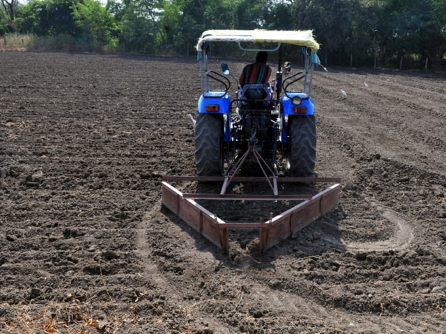 Farmer Mahesh Chouhan preparing the field for sowing wheat crop at village Dharampuri near Indore on Tuesday.