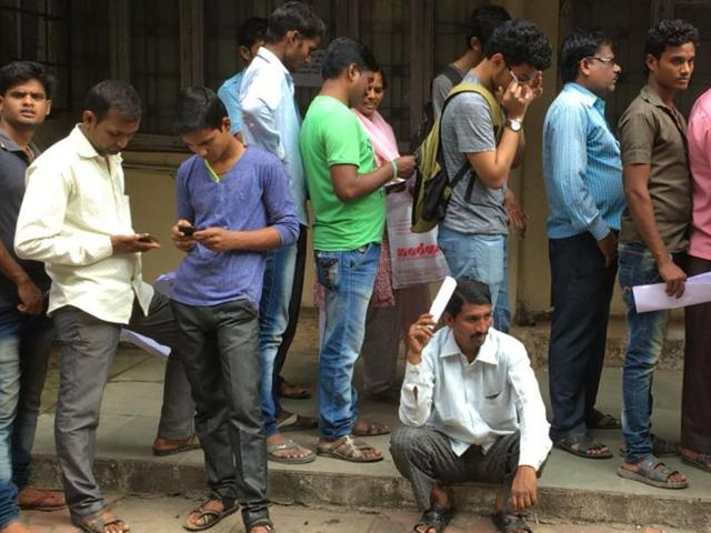 People queued up outside banks and ATMs even as their shutters were down.
