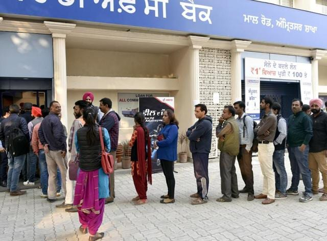 People queued up outside an HDFC bank ATM on Mall Road in Amritsar on Monday.