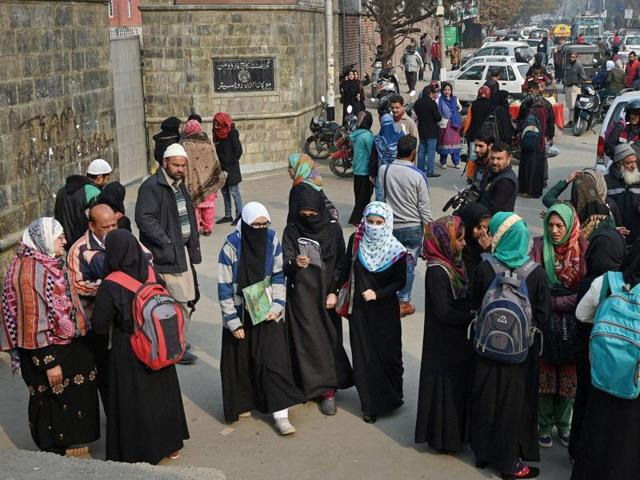 Students leave examination halls after appearing in the board examination, in Srinagar on Monday.