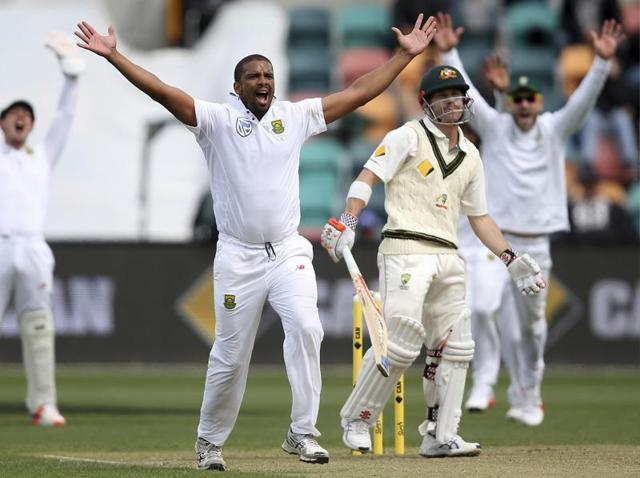 Australia's captain Steve Smith walks off the ground after being dismissed by South Africa's Kagiso Rabada.