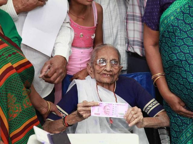 PM Narendra Modi's mother Hiraben Modi at Oriental Bank of Commerce branch at Raisan village in Gandhinagar.