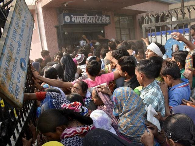 People outside a bank in Ghaziabad on Monday.