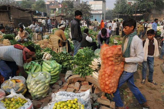Some residents are purchasing fruits and vegetables together with their neighbours to reach amounts for which vendors wouldn't have to return change.