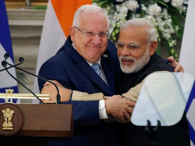 Israeli President Reuven Rivlin and India's Prime Minister Narendra Modi hug each other after reading their joint statement at Hyderabad House in New Delhi on Tuesday.